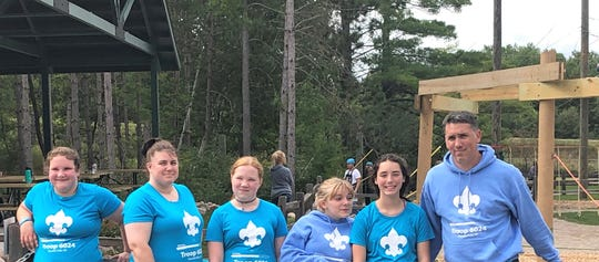 Shaun Philhower, right, founded the first girls troop last March in the Northern Lights District, Troop 6024 in Oconto Falls. Seen with him at an outing at the NEW Zoo and Adventure Park are, from right,  his daughter Kara Philhower, Mika Tassoul, Kara's mother and adult leader Stacy Gilbert and Alexis Gilbert
