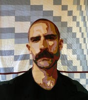 """""""JCB, A Series of Men No. 3,"""" fiber art with cotton and cotton blend fabric, primarily reclaimed men's shirts, cotton batting and cotton thread by Peter Horjus, part of the """"Textile Tableau""""exhibit through Feb. 24 at the Miller Art Museum in Sturgeon Bay.."""