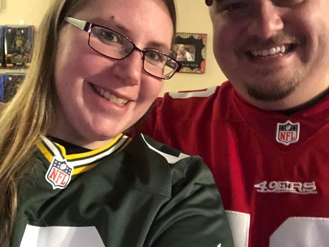 Appleton residents Jamie and Dan Bernhardt rock their favorite NFL teams' jerseys in advance of Sunday's NFC championship game between the Green Bay Packers and San Francisco 49ers.