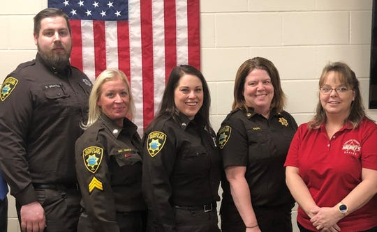 Oconto County Jail Administrator Carol Kopp, right, is seen with four recently promoted staff members. From left are Cpl. Scott Brattain, Sgt. Carrie Kempka, Cpl. Kendra Race and Lt. Mary Ruechel.