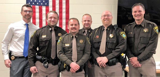 Four Oconto County deputies were recently promoted to sergeant. From left are Chief Deputy Darren Laskowski, Sgt. Chris Baribeau, Sgt. Chad Angus, Sgt. Ben Schindel, Sgt. Jordan Longsine, and Sheriff Todd Skarban.