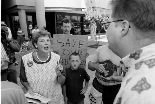In this archive photo, Tim Bell, right, who opposes the proposed gay resolution, argues with Ruth Trippi outside County Squaare before the Greenville County Council meeting on May 21, 1996.