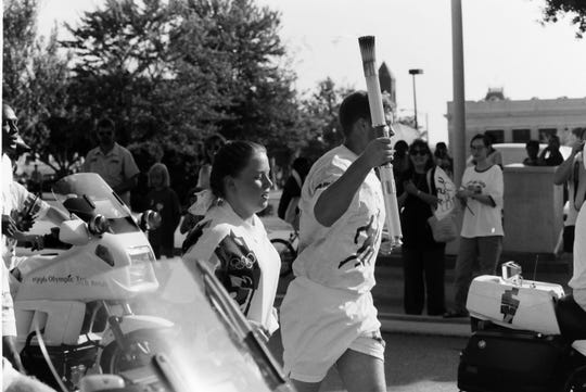 In this archive photo, The Olympic torch relay pass through downtown Spartanburg on Tuesday, June 25, 1996.