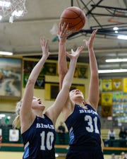 Great Falls High's Taylor VanderMars, 10, and Jorgie Hawthrone, 31, go up for a rebound during the crosstown basketball game, Thursday, against CMR.
