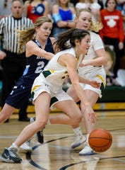 CMR's  Lauren Lindseth drives to the basket during the crosstown basketball game against Great Falls High on Thursday in the CMR Fieldhouse.
