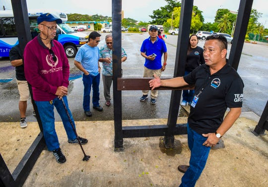 Mark Crisostomo, right, Guam Regional Transit Authority transportation supervisor, explains the lack of walls on a bus stop in place near the Hagåtna Pool during a tour of the authority's Redline bus route on Friday, Jan. 17, 2020. Crisostomo says of 151 GRTA bus stops around the island, only 13 are equipped with actual bus shelters and about 30 have signs posted to indicate their function as a GRTA bus stop. Crisostomo did say that all stops and their locations are listed at the agency's website, grta.guam.gov.