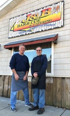 Partners John Klein, left, and Barry Burton have been cooking barbecue at the corner of Holloway and Washington streets since 2005, but they intend to retire at the end of this year.