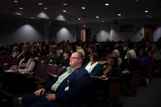 Jason Pritchard, recovery program manager with Ballad Health, sits in one of the front rows of a Tennessee Chamber of Commerce presentation on how employers can help fight the opioid crisis at Ayers Auditorium in Jackson, Tenn., on Friday, Jan. 17, 2020. Pritchard struggled with addiction to opioids and other drugs for 16 years before going through recovery and resolving to use his story to help others.