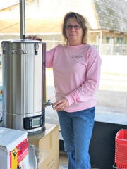 """""""I'm really happy to be here and being right on Chapman Highway,"""" said Allen Biermakens owner Deanna Pierce. """"I'm hoping this will be good for business."""" Pierce is filling the store with new equipment, such as this compact home brewing system."""