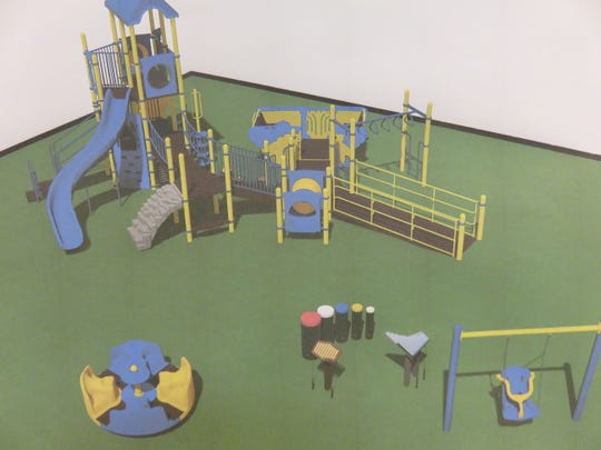 Artist's rendering on the wall at West Hills Elementary on Jan. 13, 2020, shows the look of the planned all-inclusive playground for the school.