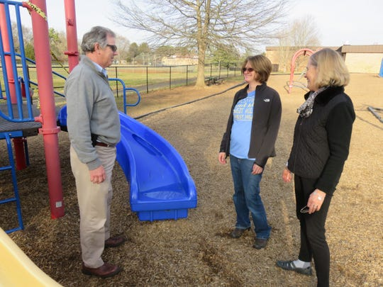 Donnie Ernst, Elizabeth Evola and Anne Crais examine some of the equipment at the West Hills Elementary playground on Jan. 13, 2020.