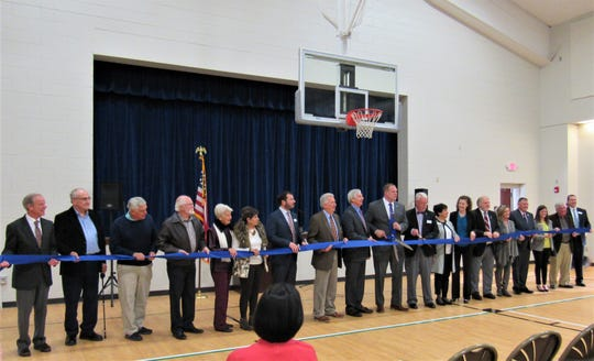 Jan. 16 was a day of celebration as both the Farragut Community Center and the West Knox County Senior Center held a joint ceremony for the new centers at 239 Jamestowne Boulevard. The gym was packed with past and present officeholders, Farragut founders, volunteers and the public, with both Knox County Mayor Glenn Jacobs and Mayor Ron Williams (center) simultaneously cutting the ribbon.