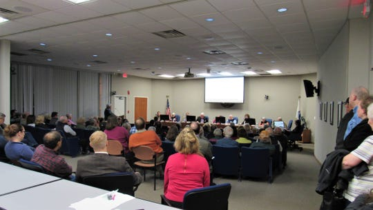 It was standing room only at the Planning Commission meeting on Jan. 16, 2020. Residents turned out in force to voice their objections to the installation of small cell towers in residential areas.