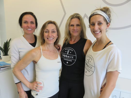 Yoga Six teachers and officials Ashly Sims, Frannie Vookles, Tracy Serrano and Brittany Charnley stand in the entrance area of the studio on Jan. 13, 2020, prior to its Jan. 27 opening.