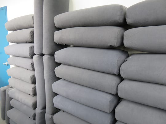 Pillow-like bolsters are lined up and available for members to use at the new Yoga Six studio in Bearden on Jan. 13, 2020.