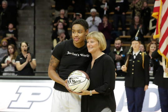 Purdue head coach Sharon Versyp presents Purdue forward Ae'Rianna Harris (32) with a special game ball for surpassing 300 career blocks, Thursday, Jan. 16, 2020 at Mackey Arena in West Lafayette.