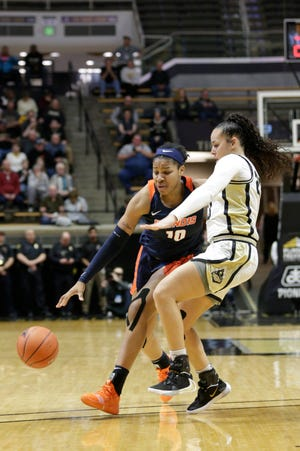 Illinois guard Jeanae Terry (10) dribbles against Purdue guard Kayana Traylor (23) during the third quarter of a NCAA women's basketball game, Thursday, Jan. 16, 2020 at Mackey Arena in West Lafayette.