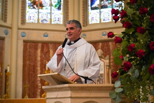 Father Florian Racine, rector of the Basilica of Saint Mary Magdalene in southern France, addresses Cathedral-Carmel School students before a Veneration with relics of the saint Friday, Jan. 17, 2020.