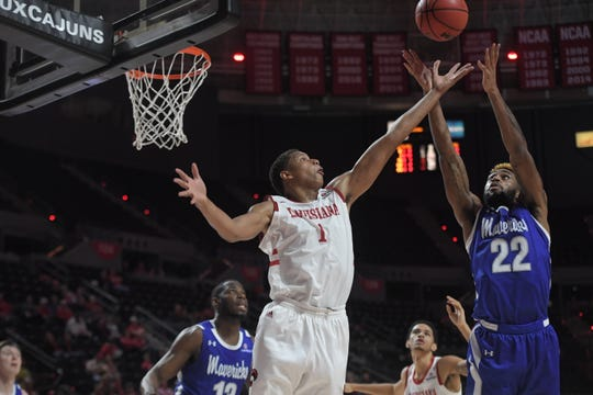 UL's Jalen Johnson (1) battles TiAndre Jackson-Young (22) for the ball in Thurday's loss to UTA.