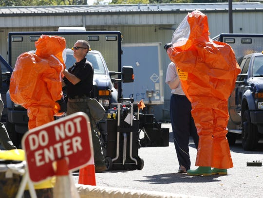 Members of the Ohio National Guard's 52nd Civil Support Team put on hazardous materials suits in September as part of a training scenario at Southeastern Correctional Institution in Lancaster. The guard team was practicing with the Ohio Department of Rehabilitation and Corrections and the Ohio Highway Patrol on responses to hazardous materials situations at a prison. The prison said about 10 staff members have been treated and released for potential chemical exposure the last several weeks.