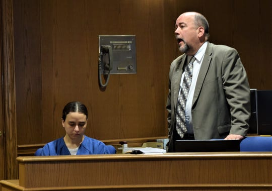 Andrew Sanderson, representing Christal Garcia, left, addresses the court during his client's plea and sentencing hearing Jan. 17. Garcia was sentenced to 4 years in prison after she pleaded guilty to two counts of aggravated arson.