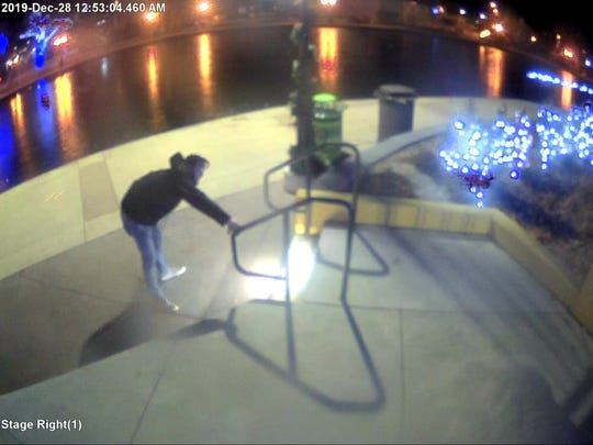 Security camera footage from Dec. 28, 2019 at the Brighton Amphitheater at the Millpond shows a man touching a railing.