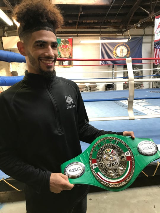 Louisville boxer Carlos Dixon is the WBC Youth Featherweight champion