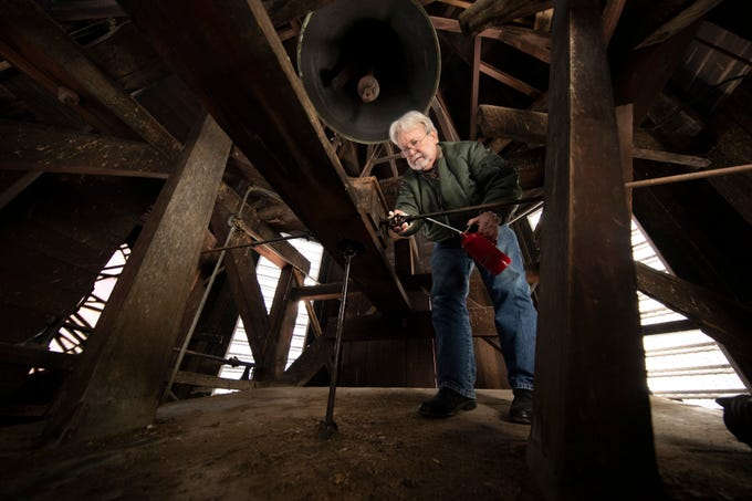 Steve Ewalt lubricates the Harrison County courthouse clock. Ewalt is a jeweler in Cynthiana and took over maintenance of the clock in 2015. Jan. 6, 2020