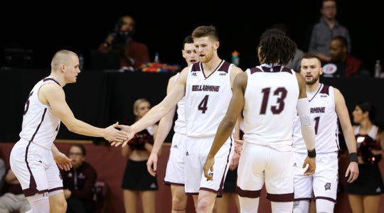 Bellarmine's Ben Weyer (4) celebrated a play with teammate CJ Fleming (25) against Missouri St. Louis during their game at Knights Hall on Jan. 16, 2020.