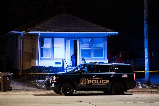 Members of the Lansing Police Department and Michigan State Police investigate the scene of a shooting on Thursday, Jan. 16, 2020 on West Malcolm X Street in Lansing. A 22-year-old man showed up at a hospital with a non-life-threatening gunshot wound, police said.