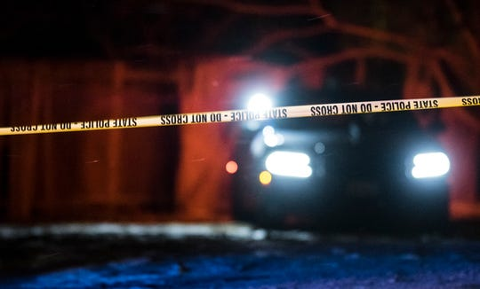 Michigan State Police and Lansing Police investigate the scene of a shooting that happened late Thursday, Jan. 16, 2020, in the 1400 block of W. Malcolm X St. in Lansing. A 22-year-old man showed up at a hospital with a non-life-threatening gunshot wound, police said.