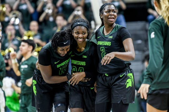 From left, Michigan State's Nia Hollie, Nia Clouden and Mardrekia Cook celebrate after defeating Ohio State on Thursday, Jan. 16, 2020, at the Breslin Center in East Lansing.
