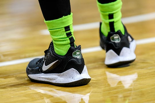 Michigan State women's basketball team players are wearing a patch on their shoes to pay tribute to Spartan Sports Network basketball radio analyst Mo Gerhardt.