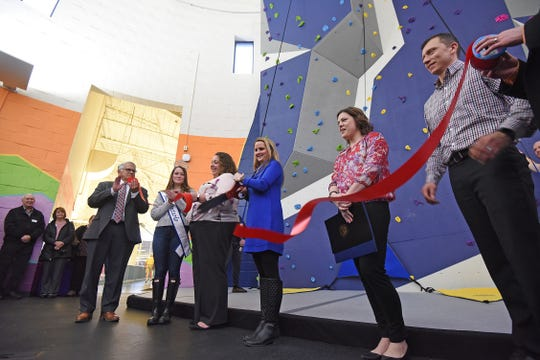 A ribbon-cutting ceremony was held Thursday afternoon to celebrate the opening of the new rock climbing wall at the Mansfield Y.