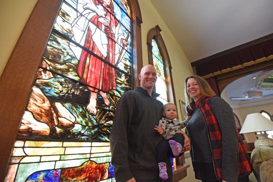 Pete and Stephanie Champer and daughter Ellie in their Old Franklin Church Wedding and Event Space.