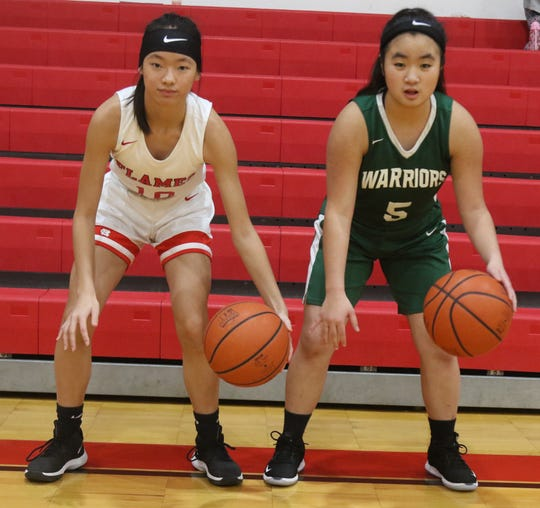 Abby Little (Left) and Maddy Lopp (Right) were both in the same orphanage in China and adopted on the same day. On Tuesday night, they played a basketball game against each other.