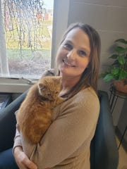 Toni Ross, holding Carl, a kitten who was recently adopted, is the new operations manager at the Humane Society of Richland County.