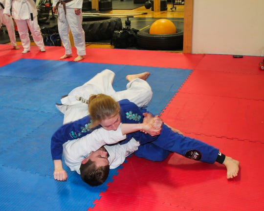 Emma Kline, 12, an orange belt in Gracie jiu-jitsu under Shawn Chitwood, trains with Keith Cole, a local resident, last week at Marion Fitness Club, 1295 Harding Hwy E., Sara Ave. entrance. Since October, Team Chitwood Martial Arts and Fitness has been offering jiu-jitsu classes at 7 p.m. Mondays and Wednesdays and 10 a.m. Saturdays. The grand opening is 7 p.m. Wednesday at The Club.