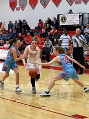 Elgin's Bekah Muselin drives to the basket against Ridgedale this season. Muselin was named to the first team of girls basketball for All-Central District.