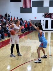 Elgin's Bekah Muselin looks for a teammate against Ridgedale earlier this year. The senior will play basketball at Ohio Northern next season, and she has been working on her shooting and ball handling with personal drills.