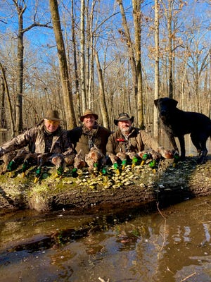 Norris McGehee (middle) with Steve Anderson (left) and Ernie Mellor (right) after a morning of duck hunting in Arkansas.