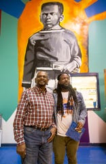 Harry Williams, one of the three students who integrated Bruce Elementary and muralist Jamond Bullock in front of a mural at Bruce Elementary on Friday Jan. 17, 2020.