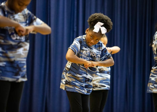 Bruce Elementary girl's step team performs during a ceremony celebrating the legacy of the three students Dwania Kyles, Harry Williams and Menelik Fombi who integrated Bruce in 1961 on Friday Jan. 17, 2020.