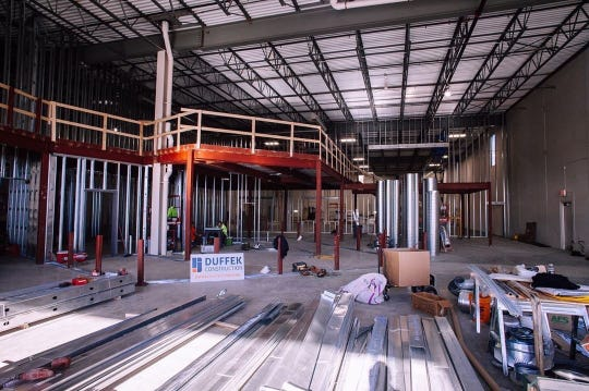 Eagle Park Brewing plans to open its Muskego brewery and distillery in April or May. Construction crews work on the mezzanine at the new site. The mezzanine will be bigger than the current taproom.