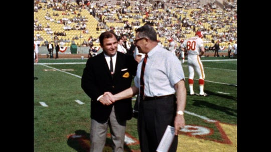 Kansas City Chiefs coach Hank Stram shakes hands with Green Bay Packers coach Vince Lombardi during Super Bowl I on Jan. 15, 1967, at Los Angeles California's Memorial Coliseum. The Green Bay Packers beat the Kansas City Chiefs, 35-10. Note the empty seats.