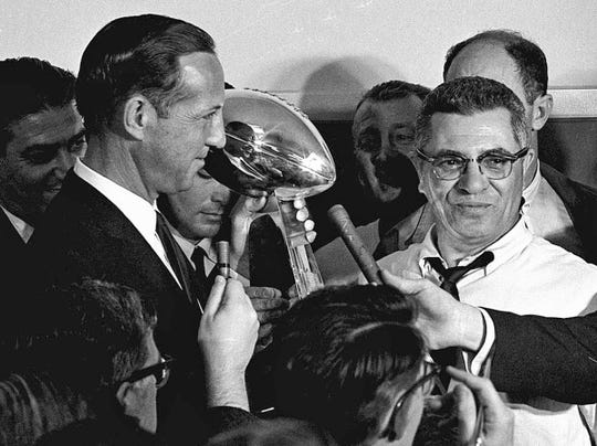 ** FILE ** In this Jan. 15, 1967 file photo, football commissioner Pete Rozelle, left, presents the trophy to Green Bay Packers coach Vince Lombardi after they beat the Kansas City Chiefs in the Super Bowl in Los Angeles. The Pittsburgh Steelers face the Arizona Cardinals in the upcoming Super Bowl XLIII in Tampa, Fla. (AP Photo, File) ORG XMIT: NY161