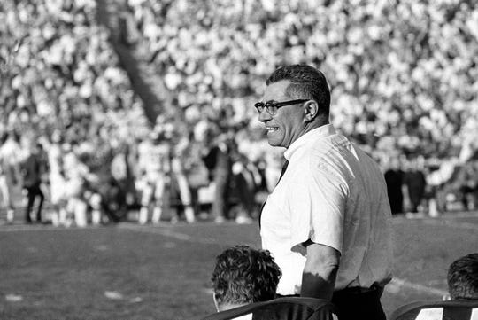 Green Bay Packers coach Vince Lombardi cheers on his champion team as they swamp the Kansas City Chiefs, 35-10 during Super Bowl I, in Los Angeles, Calif., Jan. 15, 1967.