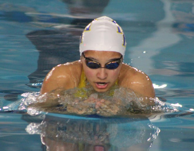 Mountain Home's Joia Traver swims to a state qualifying time in the breaststroke on Thursday evening at Conway.