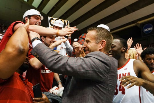 Jan 15, 2020; Tuscaloosa, Alabama, USA; Alabama Crimson Tide head coach Nate Oats celebrates with the fans after his team defeated the Auburn Tigers at Coleman Coliseum. Mandatory Credit: Marvin Gentry-USA TODAY Sports