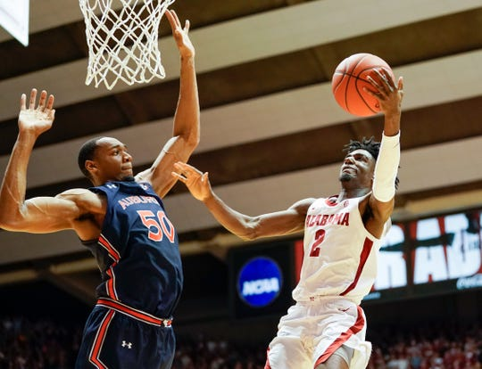Jan 15, 2020; Tuscaloosa, Alabama, USA; Alabama Crimson Tide guard Kira Lewis Jr. (2) goes to the basket against Auburn Tigers center Austin Wiley (50) at Coleman Coliseum. Mandatory Credit: Marvin Gentry-USA TODAY Sports